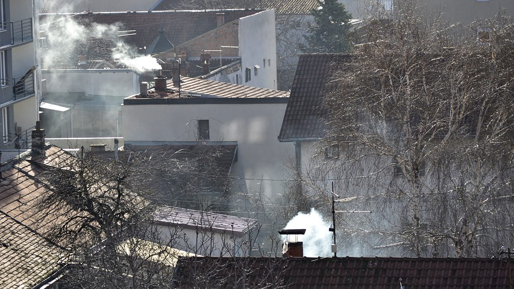 Winter cityscape, with chimneys from which the smoke pouring out - horizontal composition