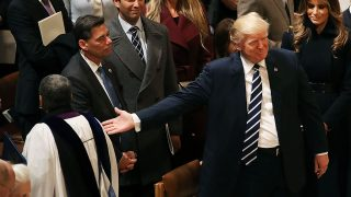WASHINGTON, DC - JANUARY 21: Members of the clergy walk past U.S. President Donald Trump after National Prayer Service concluded at the National Cathedral, on January 21, 2017 in Washington, DC.   Mark Wilson/Getty Images/AFP