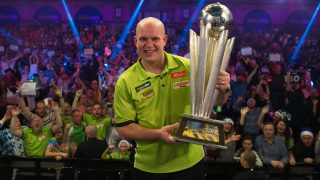 Netherlands' Michael van Gerwen poses for a photograph with the Sid Waddell trophy after his victory in the PDC World Championship darts final over Scotland's Gary Anderson at Alexandra Palace in north London on January 2, 2017. Michael van Gerwen beat Gary Anderson 7-3 in sets to win the final. / AFP PHOTO / DANIEL LEAL-OLIVAS