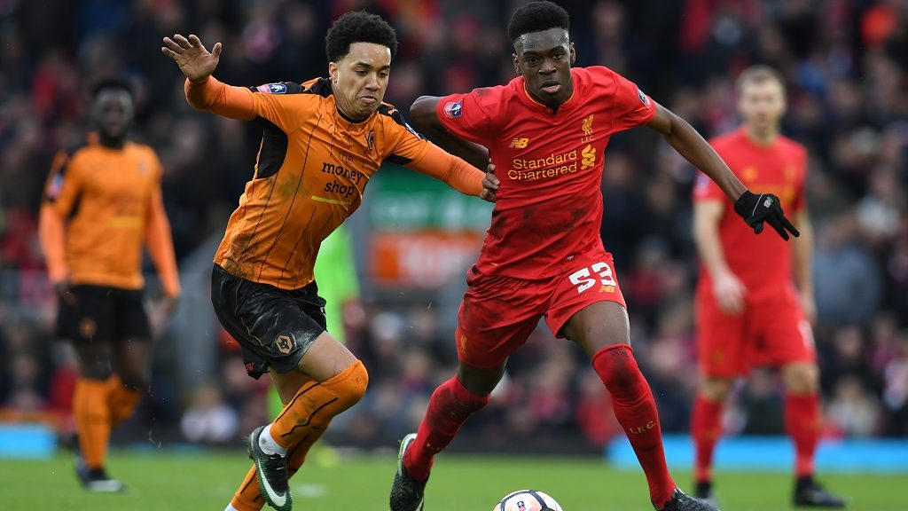 Wolverhampton Wanderers' Portuguese striker Helder Costa (L) vies with Liverpool's English midfielder Ovie Ejaria during the English FA Cup fourth round football match between Liverpool and Wolverhampton Wanderers at Anfield in Liverpool, north west England on January 28, 2017. / AFP PHOTO / Paul ELLIS / RESTRICTED TO EDITORIAL USE. No use with unauthorized audio, video, data, fixture lists, club/league logos or 'live' services. Online in-match use limited to 75 images, no video emulation. No use in betting, games or single club/league/player publications.  /