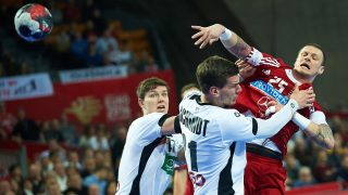 WROCLAW, POLAND - JANUARY 22: (SOUTH AFRICA AND POLAND OUT) Szabolcs Zubai of Hungary and Erik Schmidt of Germany during the 2 group match of the EHF European Men's Handball Championship between Germany and Hungary at Centennial Hall on January 22, 2016 in Wroclaw, Poland. (Photo by Lukasz Szelag/Gallo Images Poland/Getty Images)