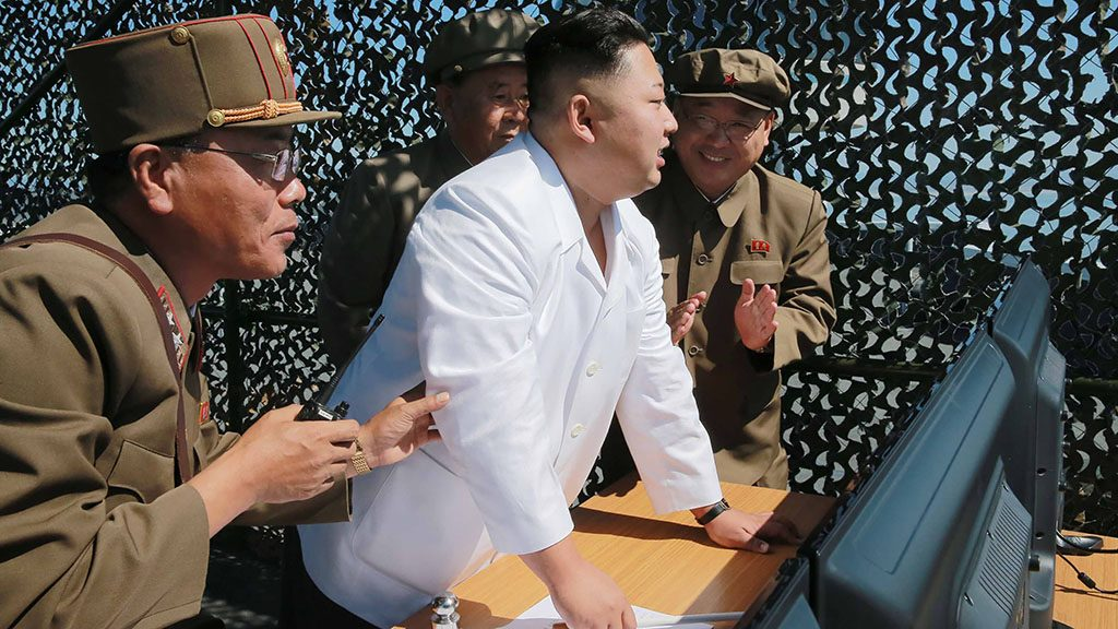 This undated picture released from North Korea's official Korean Central News Agency (KCNA) on September 20, 2016 shows North Korean leader Kim Jong-Un (C) inspecting the ground jet test of a new type high-power engine of a carrier rocket for the geo-stationary satellite at the Sohae Space Center in North Korea.North Korea has successfully tested a new, high-powered rocket engine, state media said, a move Seoul said was designed to showcase its progress towards being able to target the US east coast. / AFP PHOTO / KCNA / KCNA