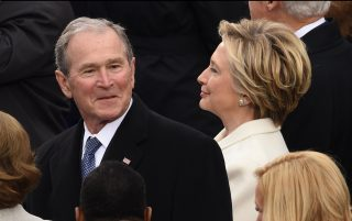 Former Us President George W Bush (L) and Democratic party candidate Hillary Clinton (R) arrive for the swering-in ceremony of newly elected US President Donald Trump in front of the Capitol in Washington on January 20, 2017.  / AFP PHOTO / Timothy A. CLARY