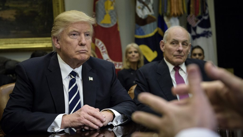 US President Donald Trump and Secretary of Homeland Security John Kelly (R) listen while Rudy Giuliani speaks a meeting on cyber security in the Roosevelt Room of the White House January 31, 2017 in Washington, DC. / AFP PHOTO / Brendan Smialowski