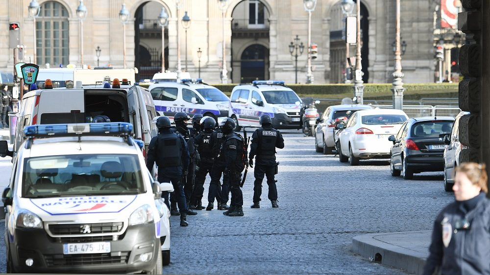 """Policemen of the GSO 93 special unit arrive at the Louvre museum on February 3, 2017 in Paris after a soldier has shot and gravely injured a man who tried to attack him. """"Serious public security incident under way in Paris in the Louvre area,"""" the interior ministry tweeted on February 3 as streets in the area were cordoned off to traffic and pedestrians.  / AFP PHOTO / ALAIN JOCARD"""