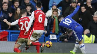Chelsea's Belgian midfielder Eden Hazard (R) shoots to scores their second goal during the English Premier League football match between Chelsea and Arsenal at Stamford Bridge in London on February 4, 2017. / AFP PHOTO / Ian KINGTON / RESTRICTED TO EDITORIAL USE. No use with unauthorized audio, video, data, fixture lists, club/league logos or 'live' services. Online in-match use limited to 75 images, no video emulation. No use in betting, games or single club/league/player publications.  /