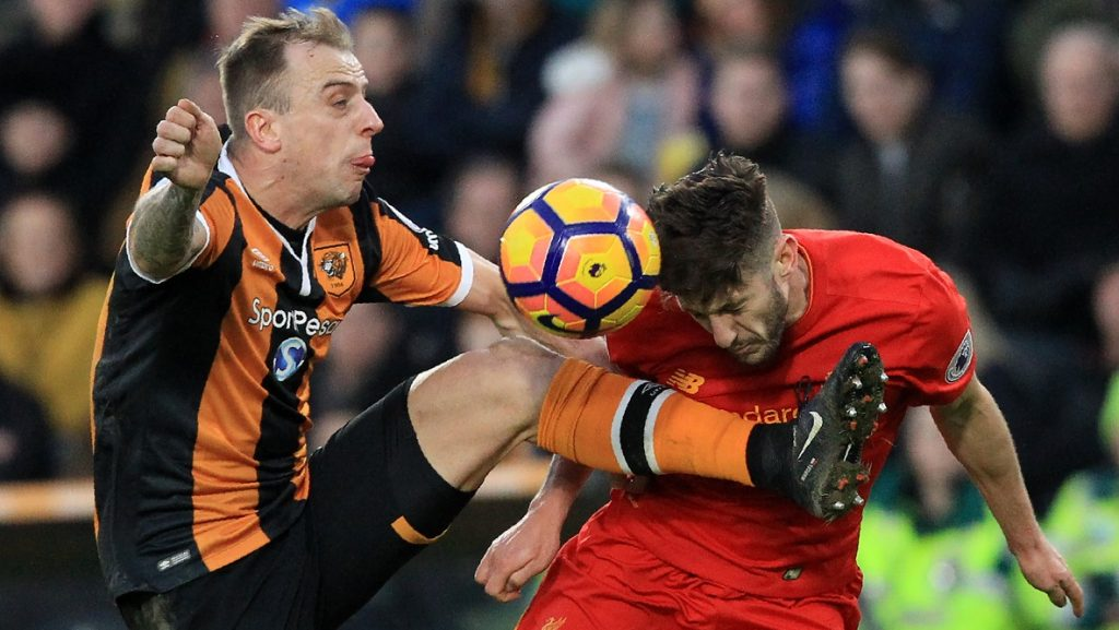 Hull City's Polish midfielder Kamil Grosicki (L) vies with Liverpool's English midfielder Adam Lallana during the English Premier League football match between Hull City and Liverpool at the KCOM Stadium in Kingston upon Hull, north east England on February 4, 2017. / AFP PHOTO / Lindsey PARNABY / RESTRICTED TO EDITORIAL USE. No use with unauthorized audio, video, data, fixture lists, club/league logos or 'live' services. Online in-match use limited to 75 images, no video emulation. No use in betting, games or single club/league/player publications.  /