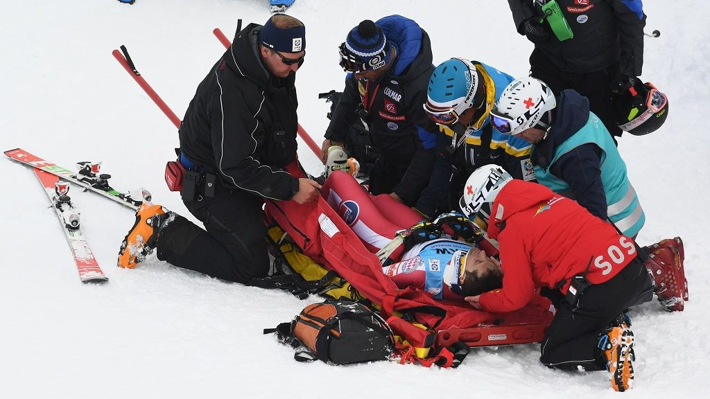 Monaco's Olivier Jenot lies in a stretcher after his crash during the men's Super-G race at the 2017 FIS Alpine World Ski Championships in St. Moritz on February 8, 2017. / AFP PHOTO / Dimitar DILKOFF