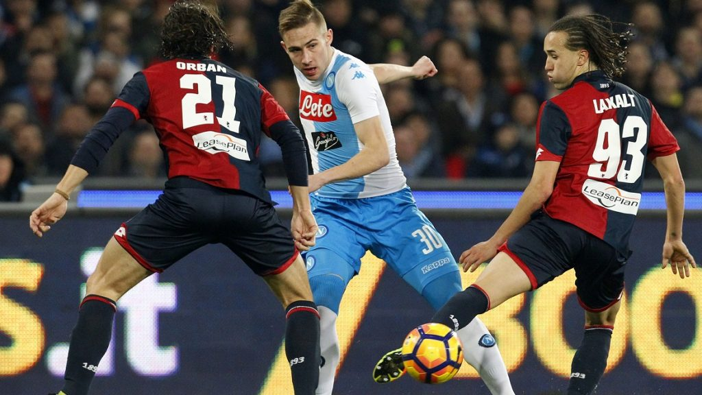 Napoli's Croatian midfielder Marko Rog (C) fights for the ball with Genoa's Uruguayan midfielder Diego Laxalt (R) and Genoa's Argentinian defender Lucas Orban during the Italian Serie A football match SSC Napoli vs Genoa CFC on February 10, 2017, at the San Paolo Stadium in Naples. / AFP PHOTO / CARLO HERMANN