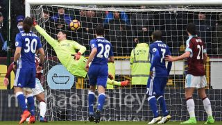 Chelsea's Belgian goalkeeper Thibaut Courtois (2nd L) cannot prevent Robbie Brady's freekick making the score 1-1, during the English Premier League football match between Burnley and Chelsea at Turf Moor in Burnley, north west England on February 12, 2017. / AFP PHOTO / Oli SCARFF / RESTRICTED TO EDITORIAL USE. No use with unauthorized audio, video, data, fixture lists, club/league logos or 'live' services. Online in-match use limited to 75 images, no video emulation. No use in betting, games or single club/league/player publications.  /