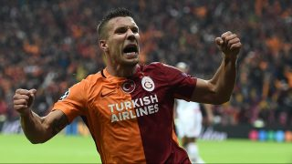 (FILES) This file photo taken on October 22, 2015 shows Galatasaray's German forward Lukas Podolski celebrating after scoring during the UEFA Champions League football match between Galatasaray AS and SL Benfica at the Ali Sami Yen Spor Kompleks stadium in Istanbul. Germany's former star striker Lukas Podolski has agreed a move from  Turkish giants Galatasaray to Vissel Kobe of Japan, a report said on February 15, 2017. The Hurriyet daily said Podolski had agreed a three year deal with the J1 side worth 15 million euros (USD 15.8 million) and Istanbul side Galatasaray would receive a transfer fee of 2.7 million euros (USD 2.85 million).  The move would take effect from June 1, meaning Podolski could play for Galatasaray until the end of the season, it said. The announcement and signing is expected in the next days.  / AFP PHOTO / OZAN KOSE