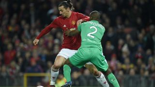 Manchester United's Swedish striker Zlatan Ibrahimovic (L) vies with Saint-Etienne's French defender Kevin Theophile-Catherineduring the UEFA Europa League Round of 32 first-leg football match between Manchester United and Saint-Etienne at Old Trafford stadium in Manchester, north-west England, on February 16, 2017. / AFP PHOTO / Oli SCARFF