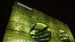 """This picture taken on October 15, 2015 shows the new headquarters of news television channel Euronews in the """"Confluence"""" district of Lyon, southeastern France. AFP PHOTO / PHILIPPE DESMAZES / AFP PHOTO / PHILIPPE DESMAZES"""