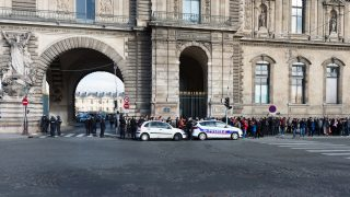 FRANCE, Paris: People evacuate the Louvre museum on February 3, 2017 in Paris, after a soldier patrolling at the museum shot and seriously injured a machete-wielding man as he attacked security forces, police said.  - Serge TENANI