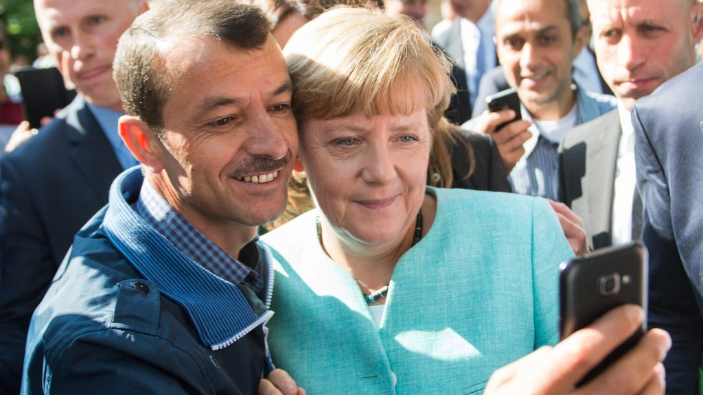 FILE- An archive picture dated 10 September 2015 shows German Chancellor Angela Merkel (CDU, R) taking a selfie with a refugee at the refugee reception centre in Berlin, Germany. Photo: Bernd von Jutrczenka/dpa