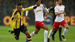 Leipzig's Marvin Compper (c) and Dortmund's Pierre-Emerick Aubameyang vie for the ball during the German Bundesliga soccer match between Borussia Dortmund and RB Leipzig in the Signal Iduna Park stadium in Dortmund, Germany, 04 January 2017.  (EMBARGO CONDITIONS - ATTENTION: Due to the accreditation guidelines, the DFL only permits the publication and utilisation of up to 15 pictures per match on the internet and in online media during the match.) Photo: Ina Fassbender/dpa