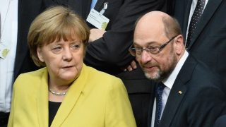 German chancellor Angela Merkel and SPD chancellor candidate MArtin Schulz stand in the plenary hall at the Reichstags building in Berlin, Germany, 12 February 2017. The federal assembly has gathered for the election of a new federal president on Sunday noon.  (ATTENTION EDITORS: IMAGE REPEAT WITH ALTERNATE CROP) Photo: Gregor Fischer/dpa