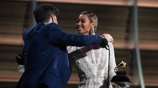 LOS ANGELES, CA - FEBRUARY 15: Producer Mark Ronson accept the Record Of The Year award for 'Uptown Funk' from Recording artist Beyonce (R) onstage during The 58th GRAMMY Awards at Staples Center on February 15, 2016 in Los Angeles, California.   Kevork Djansezian/Getty Images/AFP