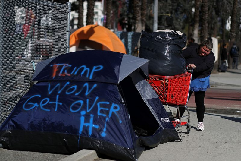 LOS ANGELES, CA - JANUARY 24: Lisa Rogers, a homeless woman, pushes a a cart filled with her possesions as she relocates her camp on January 24, 2017 in Los Angeles, California. According to a 2016 report by the U.S. Department of Housing and Urban Development, Los Angeles has the highest number of homeless people in the nation with close to 13,000 living on the streets. The annual Greater Los Angeles Homeless Count begins today and will continue through Thursday.   Justin Sullivan/Getty Images/AFP