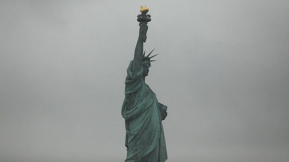 NEW YORK, NY - JANUARY 31: The Statue of Liberty stands in New York Harbor in the snow on January 31, 2017 in New York City. With President Donald Trump's executive order on immigration, the subject of who can come to America has once again become a hotly debated topic in the country. The executive order temporarily bars immigrants from Iraq, Iran, Yemen, Somalia, Sudan, and Libya, and indefinitely prevents all Syrian refugees, from entering the U.S.   Spencer Platt/Getty Images/AFP