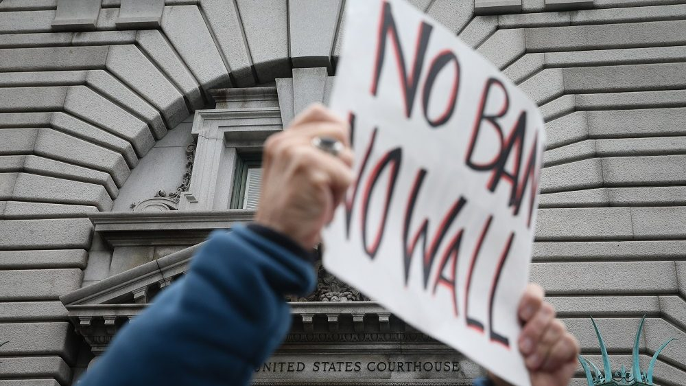 SAN FRANCISCO, CA - FEBRUARY 7: Opponents of U.S. President Donald Trump's executive order imposing a temporary immigration ban on seven Muslim-majority nations protest outside a federal appeals court February 7, 2016 in San Francisco, California. A three-judge panel heard oral arguments and will now decide whether to lift the stay or leave it in place.   Elijah Nouvelage/Getty Images/AFP