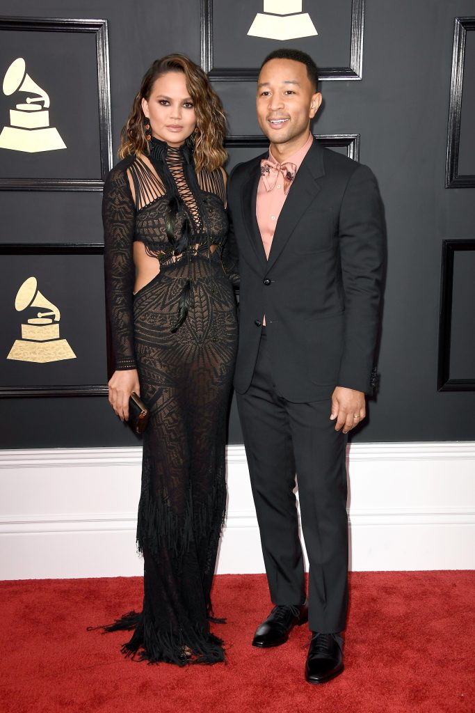 LOS ANGELES, CA - FEBRUARY 12: Model Chrissy Teigen and musician John Legend attend The 59th GRAMMY Awards at STAPLES Center on February 12, 2017 in Los Angeles, California.   Frazer Harrison/Getty Images/AFP