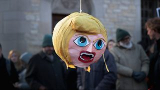 CHICAGO, IL - FEBRUARY 15: The remains of a piñata resembling President Donald Trump hangs from a tree during a protest of a visit by Corey Lewandowski, Trump's former campaign manager, at the University of Chicago on February 15, 2017 in Chicago, Illinois. Lewandowski was invited to the campus to participate in a seminar presented by U. of C.'s Institute of Politics.   Scott Olson/Getty Images/AFP