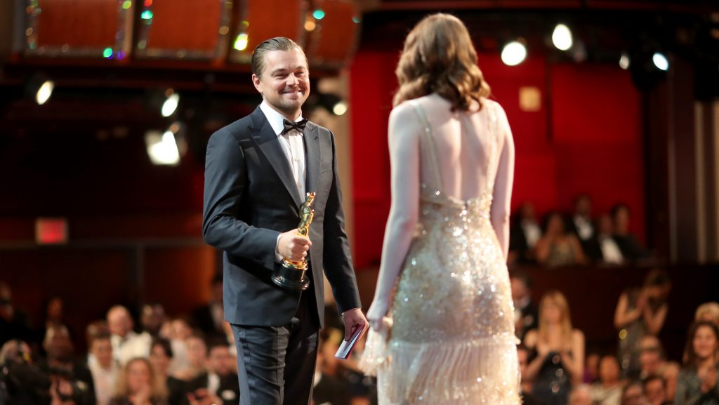HOLLYWOOD, CA - FEBRUARY 26: Actor Leonardo DiCaprio (L) and actress Emma Stone, winner of Best Actress for 'La La Land' onstage during the 89th Annual Academy Awards at Hollywood & Highland Center on February 26, 2017 in Hollywood, California.   Christopher Polk/Getty Images/AFP