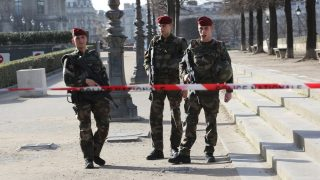 PARIS, FRANCE - FEBRUARY 03: Police take security measures in front of the Louvre Museum after a soldier shot and wounded a man, in Paris, France on February 3, 2017 in Paris, France. A soldier shot and wounded a man who tried to attack him with a knife after being prevented from entering an underground shopping mall that connects to Paris's Louvre Museum on Friday. A nearby metro station -- Palais Royal - Louvre Museum -- was closed to the public, the city transport operator RATP said. The Louvre has also been closed. Mustafa Sevgi / Anadolu Agency