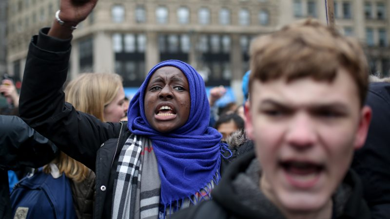 NEW YORK, UNITED STATES - FEBRUARY 7: High School students stage a protest against US President Donald J. Trump and his policies including his order of  banning entry of citizens from seven Muslim-majoirty countries to the US at Foley square in the Manhattan borough of New York, USA on February 7, 2017. Mohammed Elshamy / Anadolu Agency