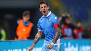Lucas Biglia (L) celebration after the penalty of 1-0 scored at Olimpico Stadium in Rome, Italy on February 13, 2017