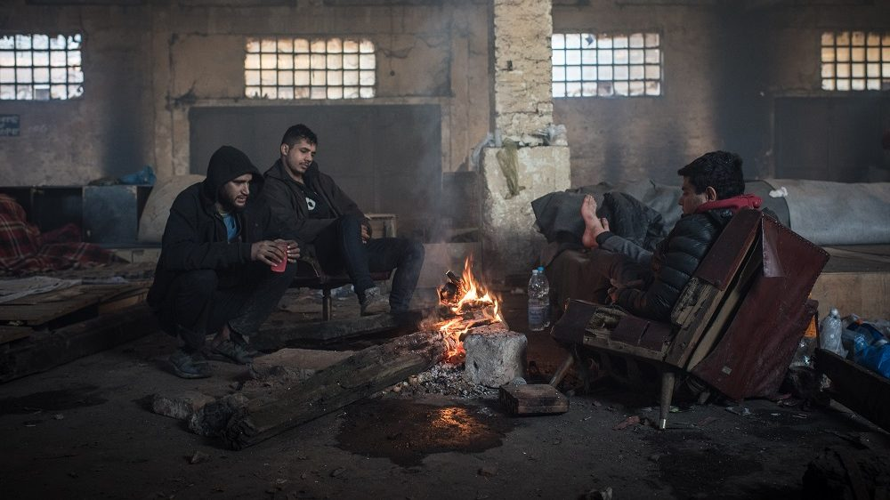 Migrants in Belgrade, on January 16, 2017. Nearly 7,000 asylum-seekers are currently stuck in Serbia as a result of tight border controls in Hungary and Croatia. Unwilling to take accommodation in state-run camps, more than 1,000 of these migrants and refugees have occupied abandoned warehouses and public spaces in Belgrade where they suffer appalling conditions and lethal winter cold. (Photo by Diego Cupolo/NurPhoto)