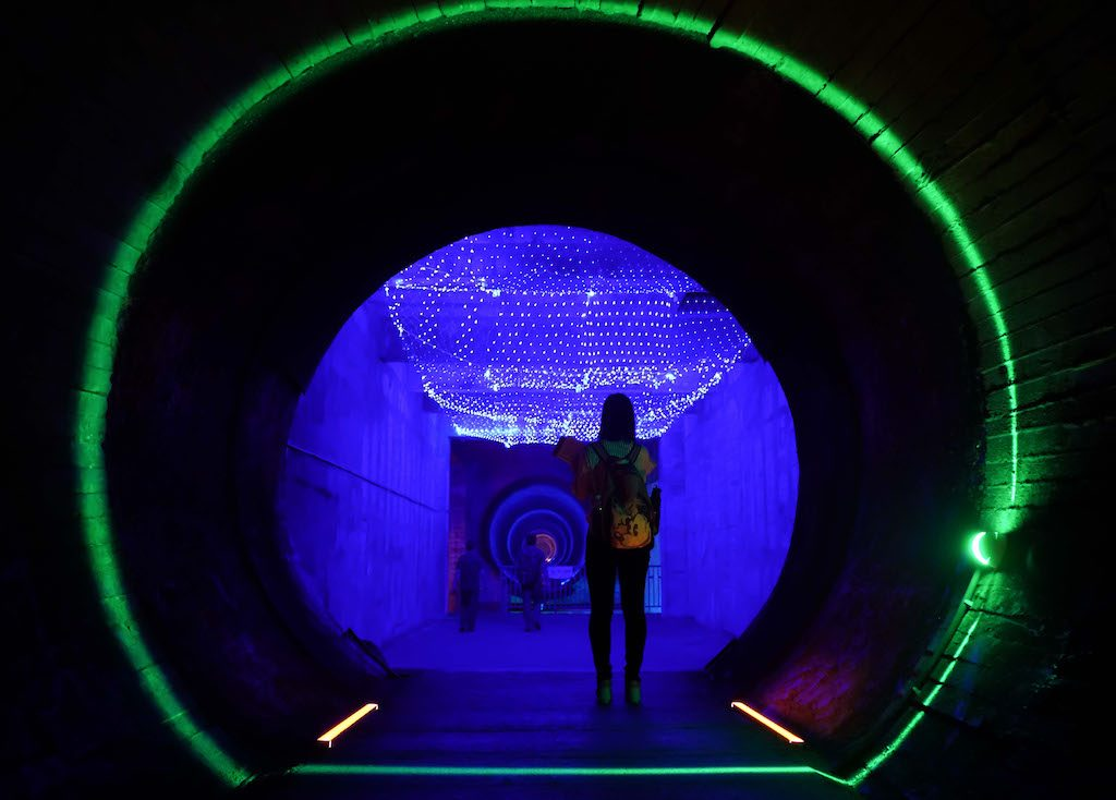 Tourists visit the 816 underground nuclear military plant in Fuling, southwest China's Chongqing Municipality, Sept. 25, 2016. The 816 underground nuclear military plant, once a highly confidential military base, opened to public on Monday after renovation.  The base was built in 1960s and first opened to tour groups in 2010.