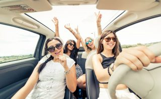 49082585 - group of girls having fun with the car. taking selfie hile driving