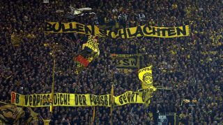 Dortmund's fans collectively show banners criticizing the Red Bull concept before the German Bundesliga soccer match between Borussia Dortmund and RB Leipzig in the Signal Iduna Park stadium in Dortmund, Germany, 04 January 2017. Photo: Ina Fassbender/dpa