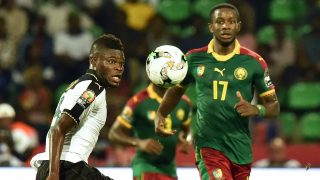 Ghana's midfielder Thomas (L) challenges Cameroon's midfielder Arnaud Sutchuin-Djoum during the 2017 Africa Cup of Nations semi-final football match between Cameroon and Ghana in Franceville on February 2, 2017. / AFP PHOTO / ISSOUF SANOGO