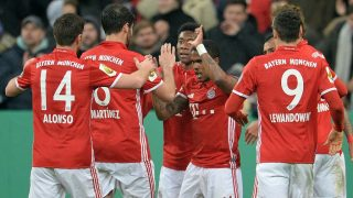 MUNICH, GERMANY - FEBRUARY 7: Douglas Costa (C) of Munich celebrates his goal with his team-mates during the DFB Cup soccer match between FC Bayern Munich and VfL Wolfsburg at the Allianz Arena in Munich, Germany on February 7, 2017. Andreas Gebert / Anadolu Agency