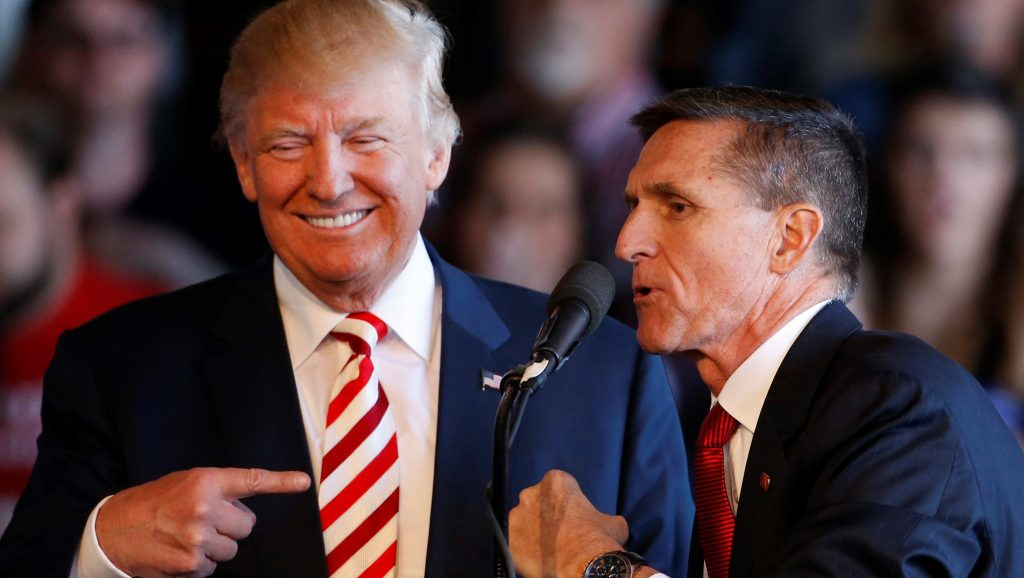 GRAND JUNCTION, CO - OCTOBER 18: Republican presidential candidate Donald Trump (L) jokes with retired Gen. Michael Flynn as they speak at a rally at Grand Junction Regional Airport on October 18, 2016 in Grand Junction Colorado. Trump is on his way to Las Vegas for the third and final presidential debate against Democratic rival Hillary Clinton.   George Frey/Getty Images/AFP