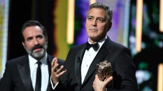 PARIS ,FRANCE-FEBRUARY 24: Actor George Clooney delivers a speech next to actor Jean Dujardin as he receives an Honorary Cesar Award at the 42nd Cesar Awards ceremony at Salle Pleyel in Paris, France on February 24, 2017.