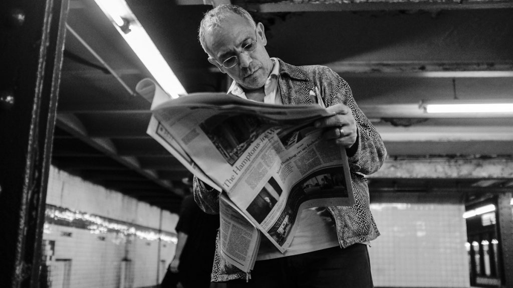 NEW YORK, NY - MAY 10: A man reads The New York Times newspaper May 10, 2014 while waiting for a subway in New York City. (Photo by Robert Nickelsberg/Getty Images)