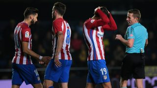 "Atletico Madrid's French defender Lucas Hernandez (R) gestures after missing an attempt on goal during the Spanish league football match Villarreal CF vs Club Atletico de Madrid at El Madrigal stadium in Vila-real on December 12, 2016. / AFP PHOTO / Jose Jordan / ""The BYLINE  of this photo by JOSE JORDAN  has been modified in AFP systems in the following manner: [Jose Jordan] instead of [Antonio del Toro]. Please immediately remove the erroneous mention[s] from all your online services and delete it (them) from your servers. If you have been authorized by AFP to distribute it (them) to third parties, please ensure that the same actions are carried out by them. Failure to promptly comply with these instructions will entail liability on your part for any continued or post notification usage. Therefore we thank you very much for all your attention and prompt action. We are sorry for the inconvenience this notification may cause and remain at your disposal for any further information you may require."""