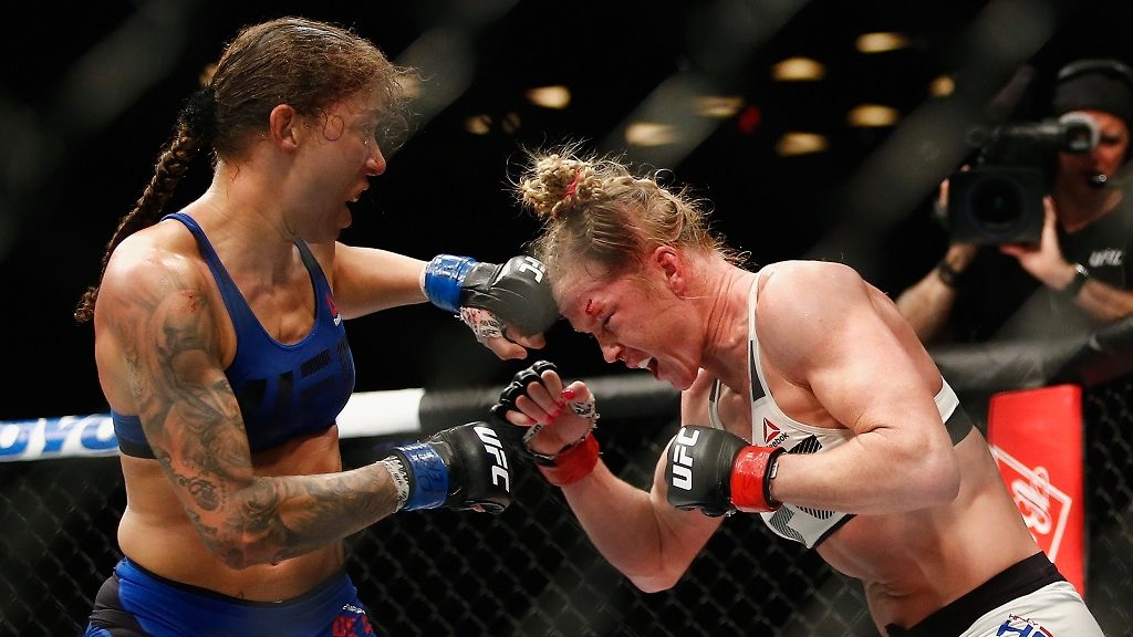 NEW YORK, NY - FEBRUARY 11: (L-R) Germaine de Randamie of The Netherlands throws a punch against Holly Holm of United States in their UFC women's featherweight championship bout during UFC 208 at the Barclays Center on February 11, 2017 in the Brooklyn Borough of New York City.   Anthony Geathers/Getty Images/AFP