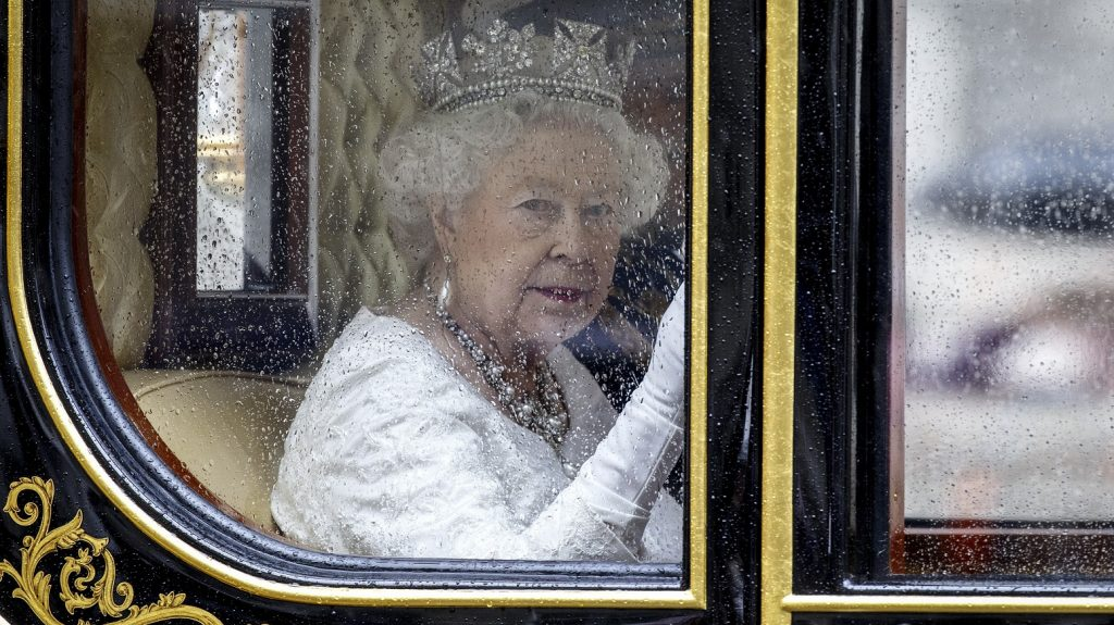 LONDON, UNITED KINGDOM - MAY 18: Britain's Queen Elizabeth II travels from the Houses of Parliament to Buckingham Palace after the Queen addressed the State Opening of Parliament in London, England on May 18, 2016. The State Opening of Parliament marks the formal start of the parliamentary year and the Queen's Speech sets out the governments agenda for the coming session. Tolga Akmen / Anadolu Agency