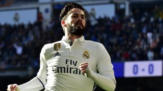 Real Madrid's midfielder Isco celebrates after scoring during the Spanish league football match Real Madrid CF vs Granada FC at the Santiago Bernabeu stadium in Madrid on January 7, 2017. / AFP PHOTO / GERARD JULIEN