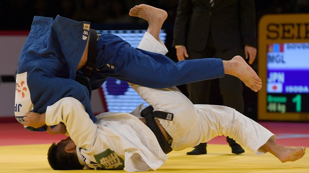 Altansukh Dovdon of Mongolia (bottom) attempts to throw Japan's Norihito Isoda during the men's under 66-kilogram bronze medal match at the Judo Grand Slam tournament in Tokyo on December 2, 2016. / AFP PHOTO / TOSHIFUMI KITAMURA