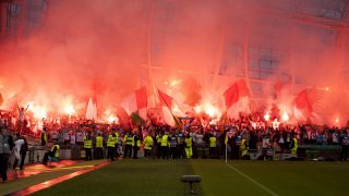 Supporters of Legia Warsaw with flares pictures before the UEFA Champions League Play-Offs 1st leg between Dundalk FC and Legia Warsaw at Aviva Stadium in Dublin, Ireland on August 17, 2016 (Photo by Andrew Surma/NurPhoto)