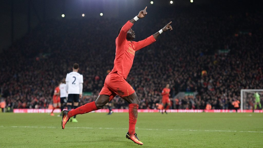 Liverpool's Senegalese midfielder Sadio Mane celebrates after scoring the opening goal of the English Premier League football match between Liverpool and Tottenham Hotspur at Anfield in Liverpool, north west England on February 11, 2017. / AFP PHOTO / Oli SCARFF / RESTRICTED TO EDITORIAL USE. No use with unauthorized audio, video, data, fixture lists, club/league logos or 'live' services. Online in-match use limited to 75 images, no video emulation. No use in betting, games or single club/league/player publications.  /