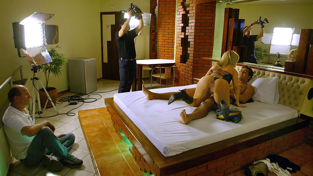 (FILE) Brazilian porno actress Judie and actor Tony have sex during the recording of a new movie produced by Buttman, specialized in pornographic films 19 August, 2004 in Barueri, 25 km north of Sao Paulo, Brazil.  AFP PHOTO/Mauricio LIMA / AFP PHOTO / MAURICIO LIMA