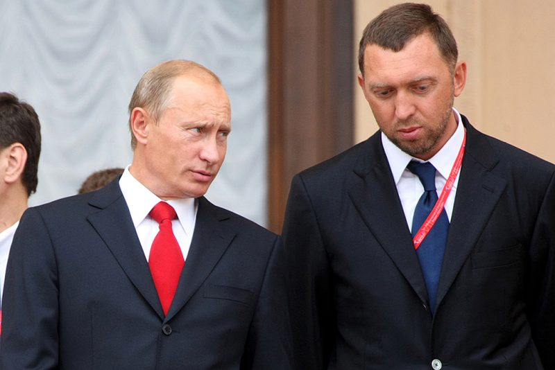 """Russian Prime Minister Vladimir Putin (L) speaks with Oleg Deripaska, head of """"The base element"""" company at the International Investment Forum in Sochi on September 19, 2008. Putin rejected the prospect of a new Cold War with the West and said Russia wanted further integration into the world economy. AFP PHOTO / RIA NOVOSTI / POOL / ILIA PITALEV / AFP PHOTO / RIA NOVOSTI / ILIA PITALEV"""