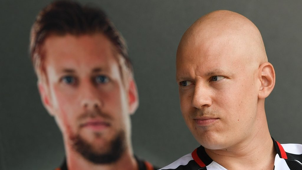 Frankfurt's defeneder Marco Russ who is suffering from cancer stands next to his portrait at the event for the Eintracht Frankfurt season opening in the Commerzbank-Arena in Frankfurt, Germany, 14 August 2016. Photo: ARNE DEDERT/DPA